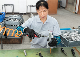 a worker assembling brake parts' components